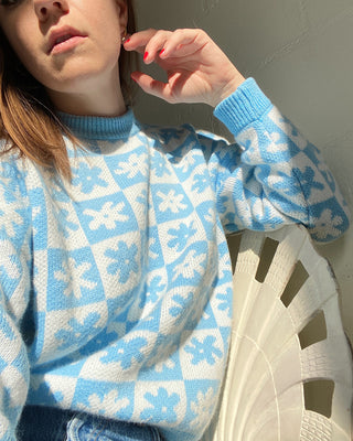 light blue and white daisy check sweater shown on model