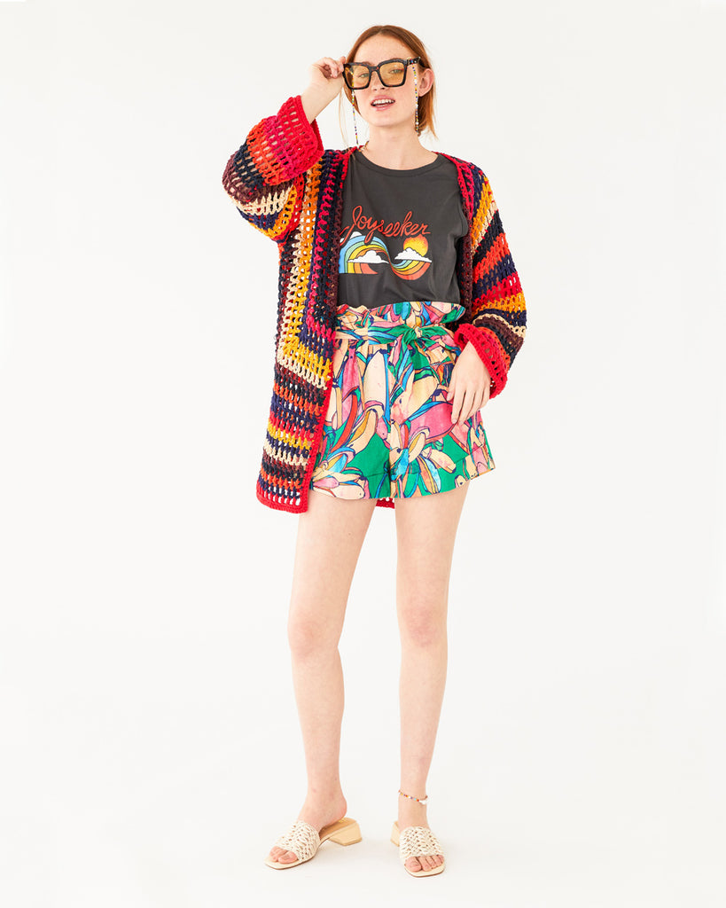 rainbow colored banana pattern shorts paired with a graphic tee and a cardigan