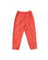 Red and white floral printed pants with cropped length and button closure laying flat on white background to show back