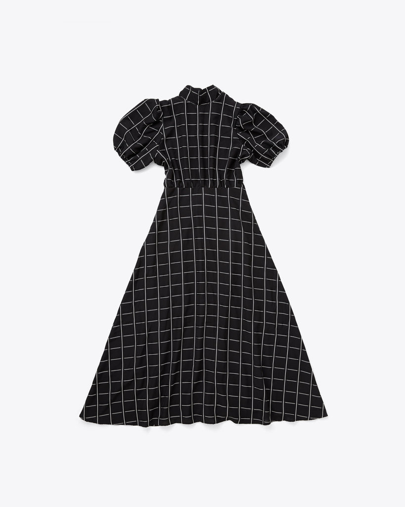 black dress with white checked lines and a puff sleeve