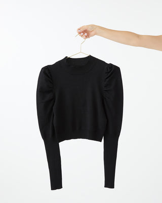 Black turtleneck with rouched shoulders.