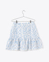white tiered mini skirt with blue chintz print and lace trim detail
