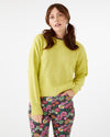 women wearing floral pants and a lime green sweater