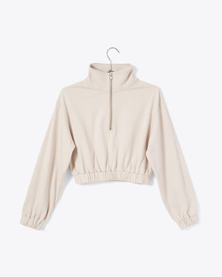 sand colored half zip sweatshirt with mock neck and cinched waist and arm cuffs shown on hanger (FRONT)