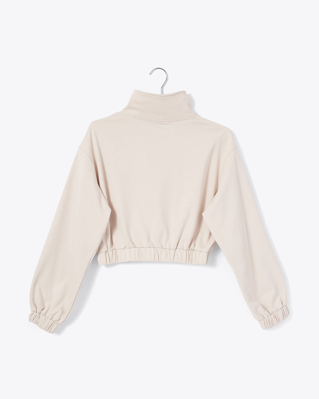sand colored half zip sweatshirt with mock neck and cinched waist and arm cuffs shown on hanger (BACK)