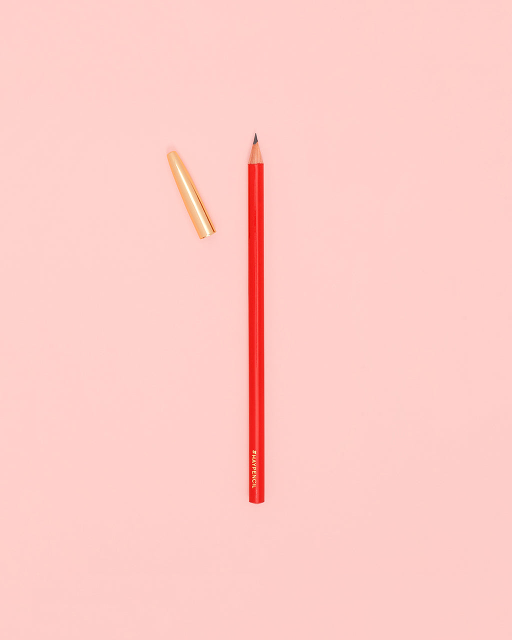 Red pencil with gold cap off to the side.