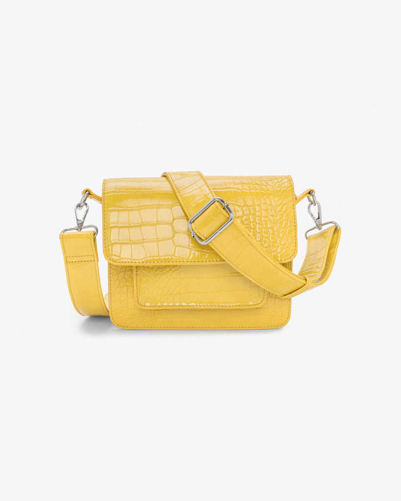 small yellow crossbody with a reptile texture, front pocket, and an adjustable strap