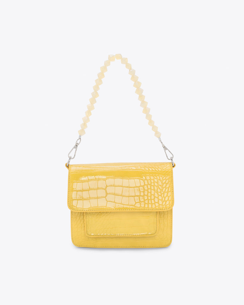 small yellow purse shown with a yellow crystal handle that is sold separately