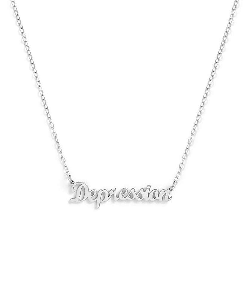 'Depression' pendant hanging from chain.