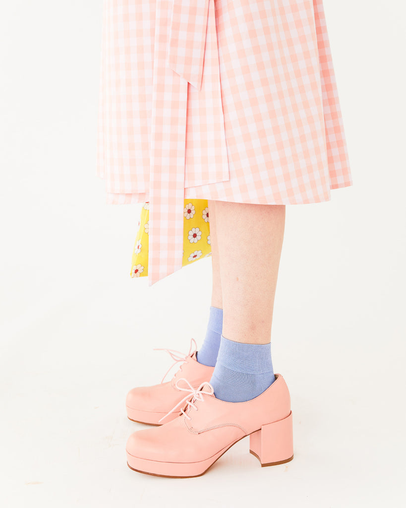 light pink platform shoes with a heel shown with blue socks