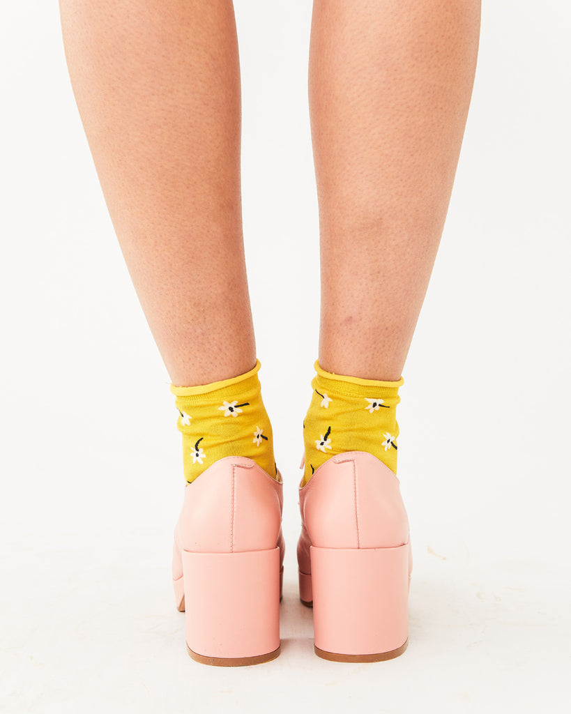 light pink platform shoes with a heel shown with yellow socks
