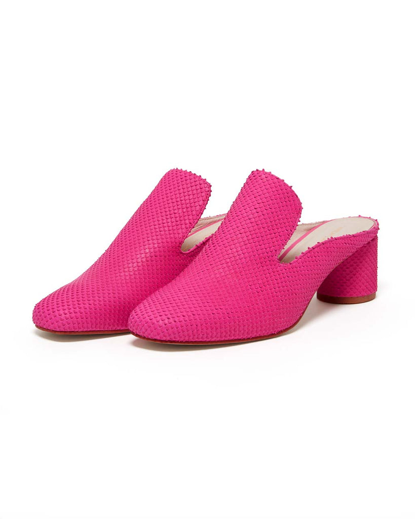 aide view of textured leather mules in hot pink