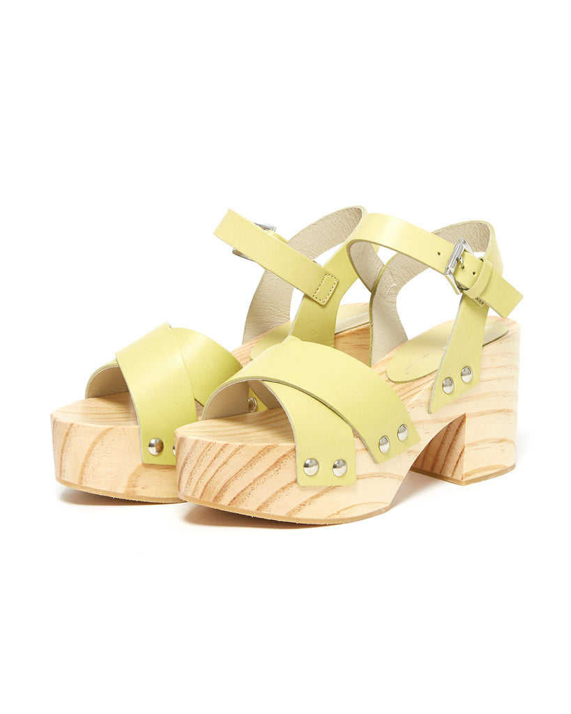 side view of wooden clog sandals with yellow leather straps
