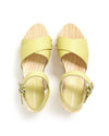 top view of wooden soled clog sandals with yellow straps
