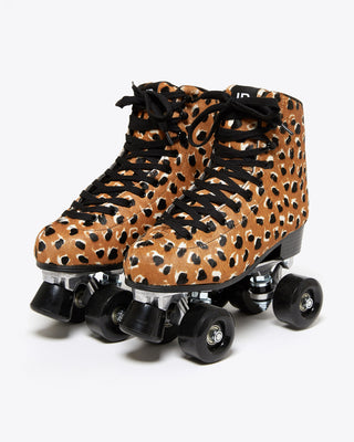 roller skates in toffee brown with black and white cheetah print with black laces and black soles, black toe stop and black wheels.