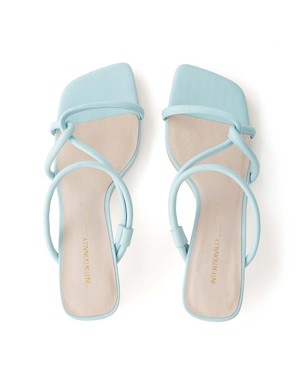 top view of a pair of baby blue sandals