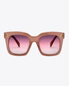 pink thick rimmed sunglasses with gradient pink lenses