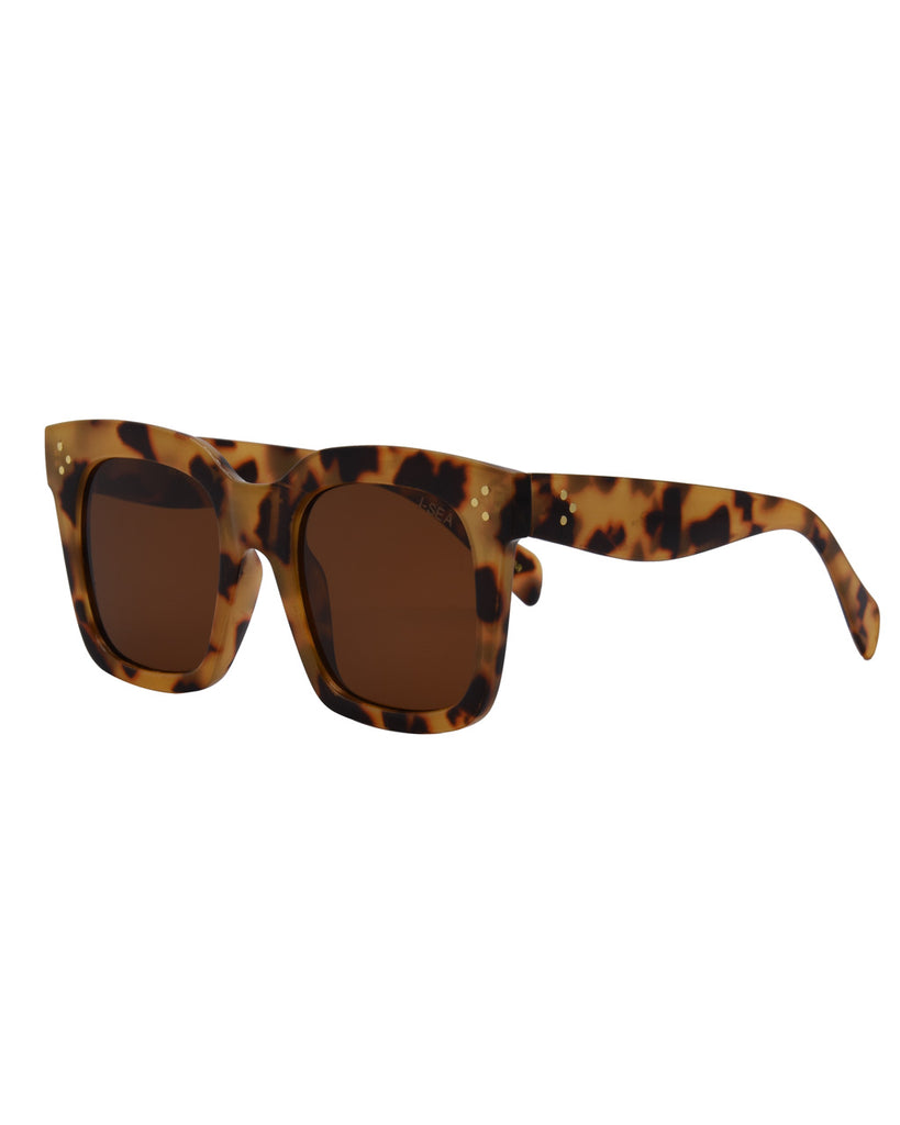 yellow tortoise thick rimmed sunglasses with brown lenses