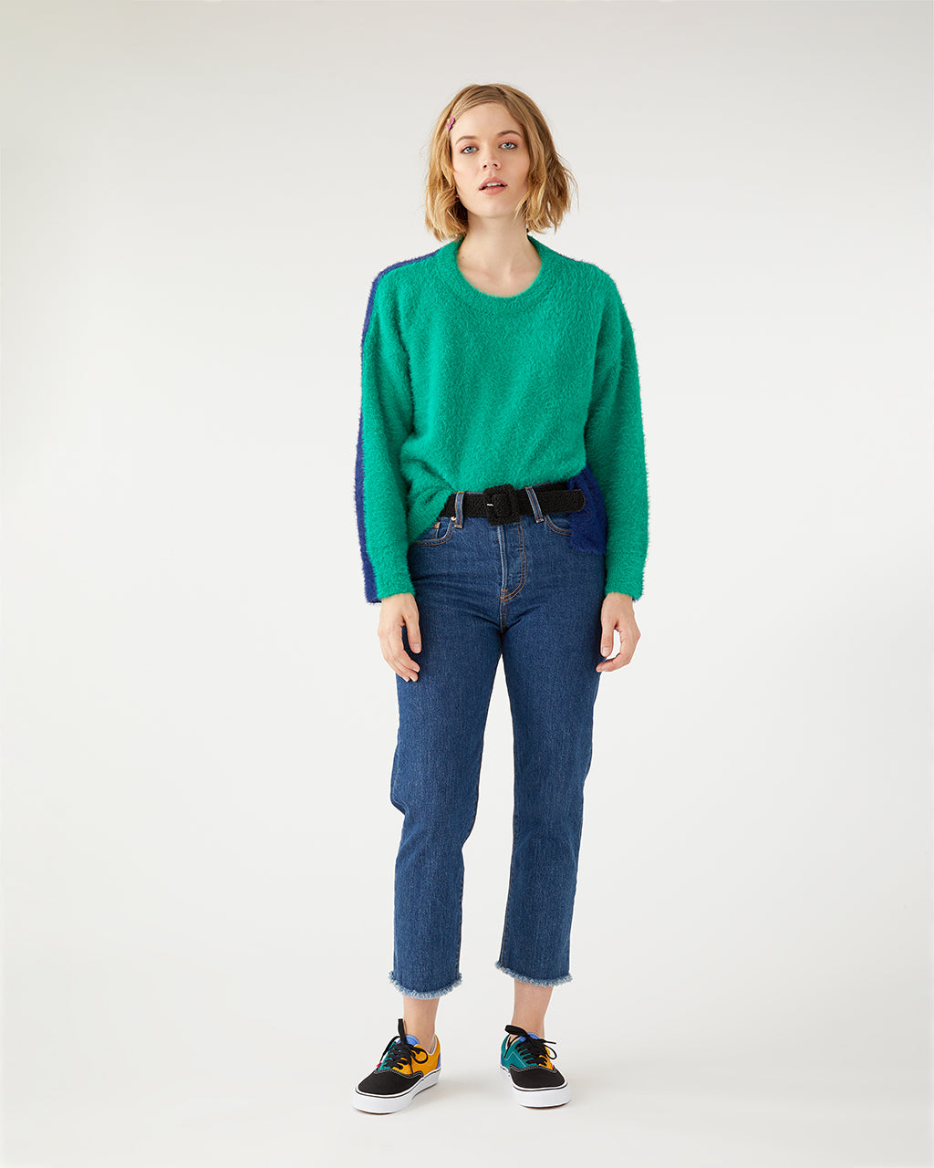 Colorblock sweater in green and navy.