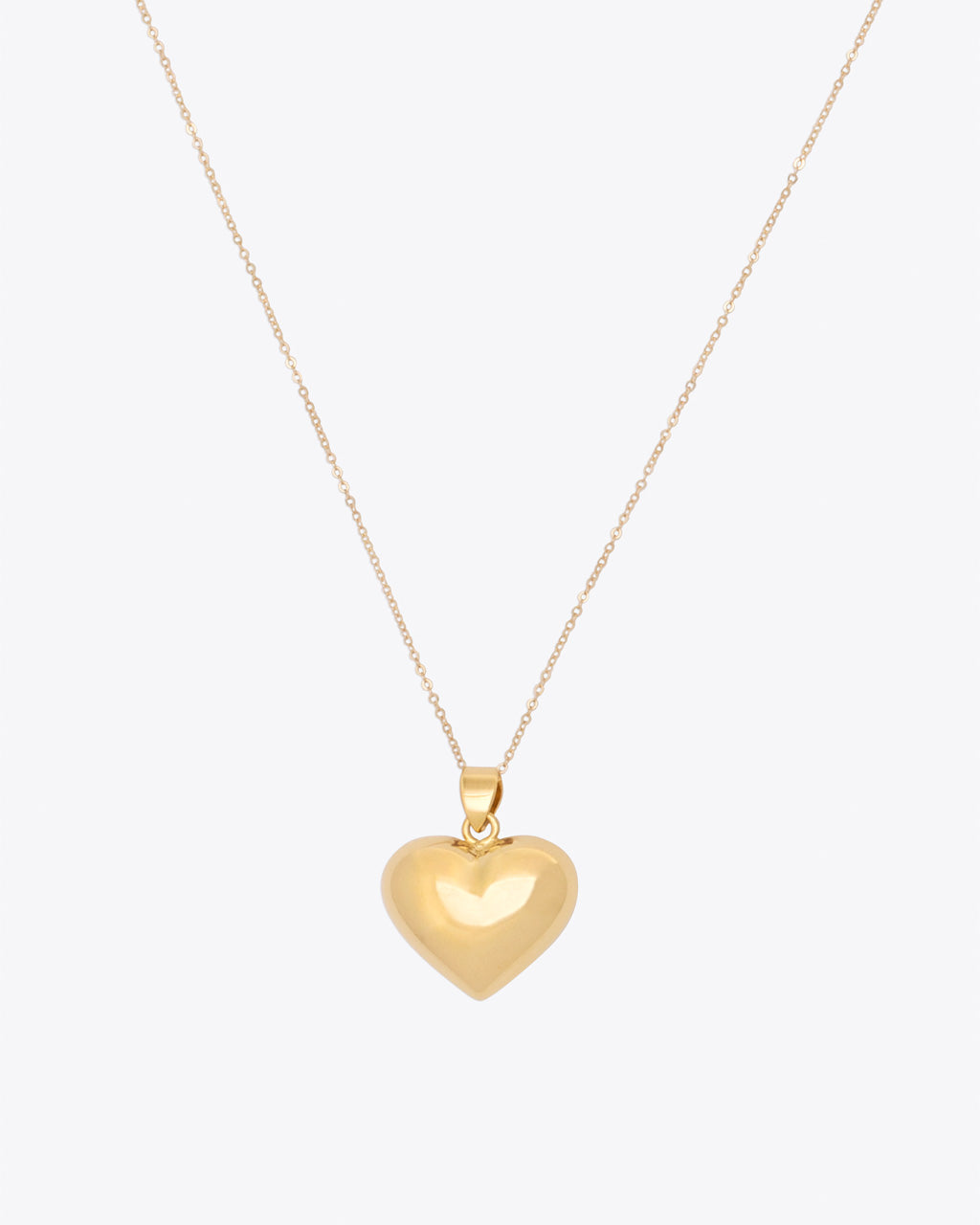 Gold heart pendant on gold chain