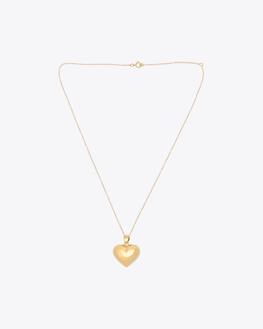 Gold heart pendant on gold chain with circle clasp