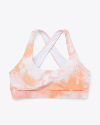 scoop neck sports bra with crossback straps in peach and white tie dye print.