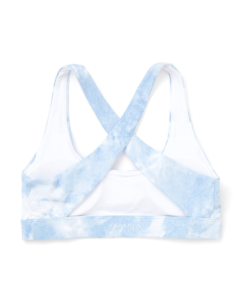 back view of blue and white tie dye sports bra with a criss cross back