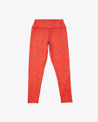 red leggings with a splattered dot design