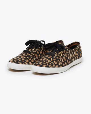 black low profile keds with a leopard pattern