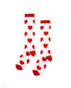 Tall white tube socks with a red heart pattern, red trim, toe, and heel.