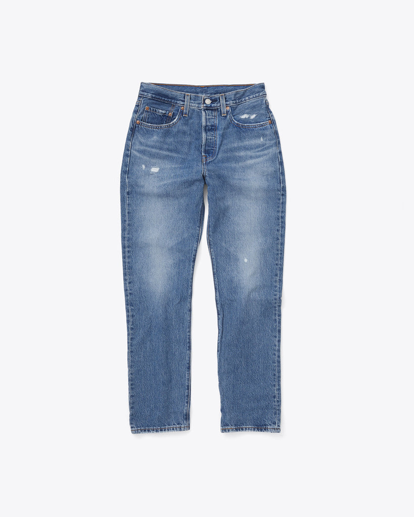 dark wash blue jeans with a straight leg fit and slight distressing