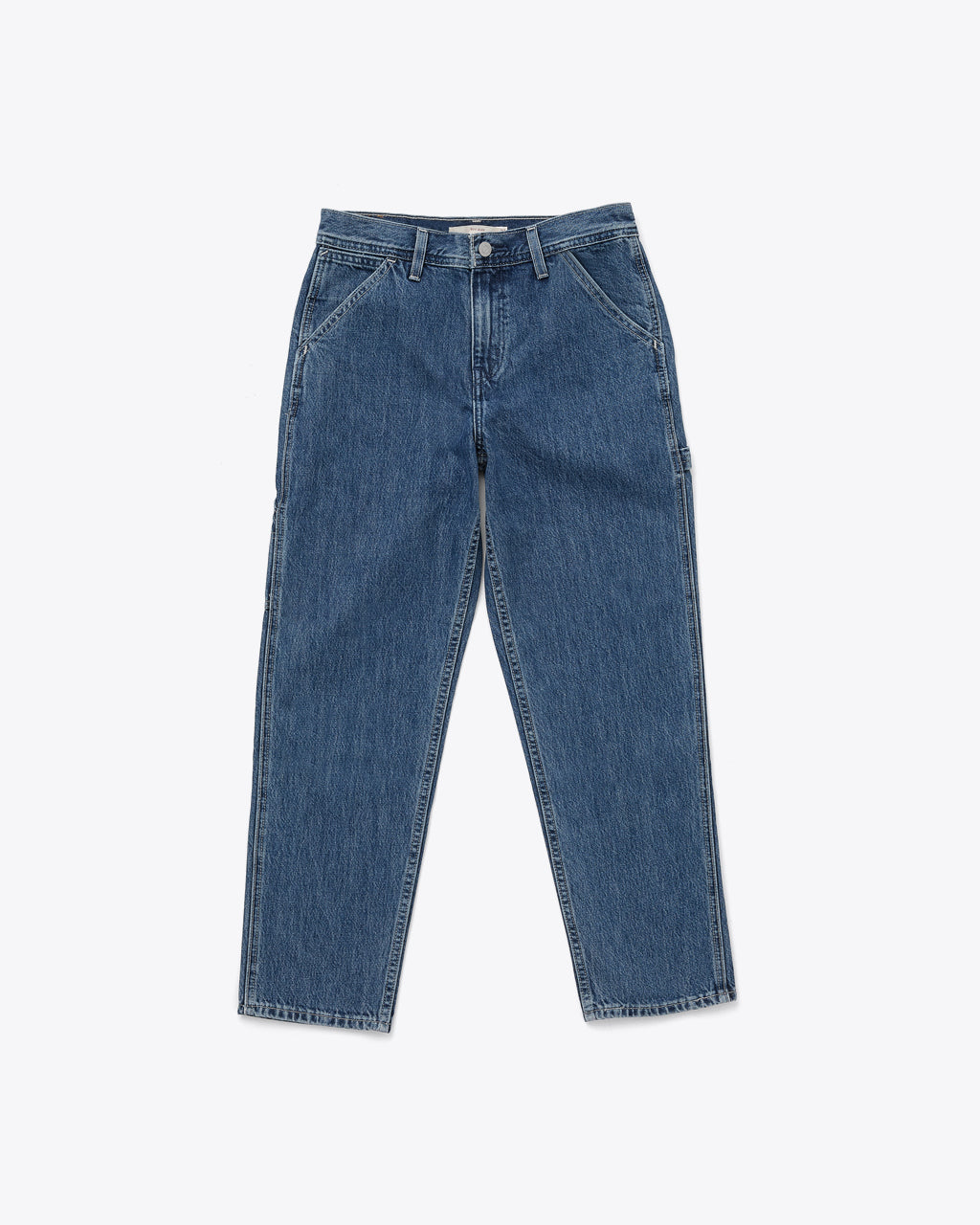 medium wash jeans with a loose fit and a straight leg