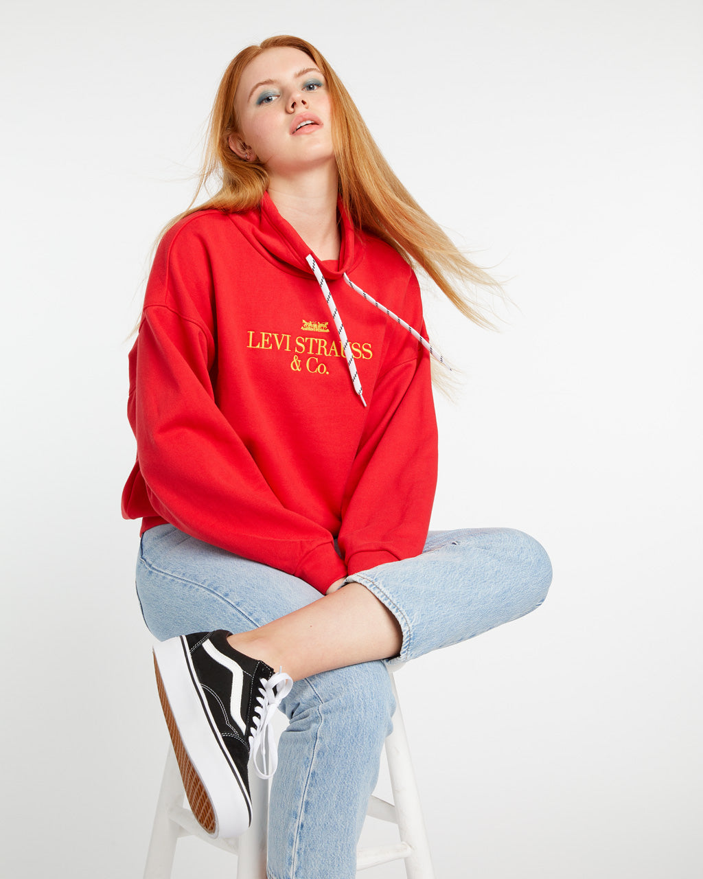 Red funnel neck sweatshirt with Levi's logo.