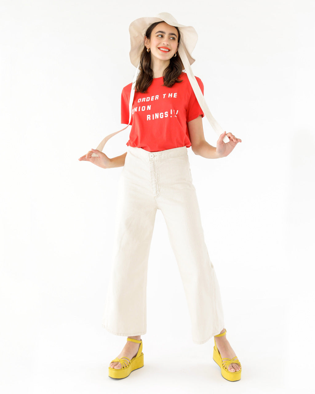 off white wide leg jeans paired with a red graphic tee shown on model