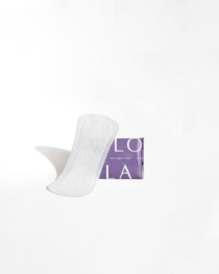 single panty liner shown with packaging