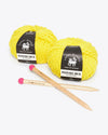 bright yellow yarn with knitting needles