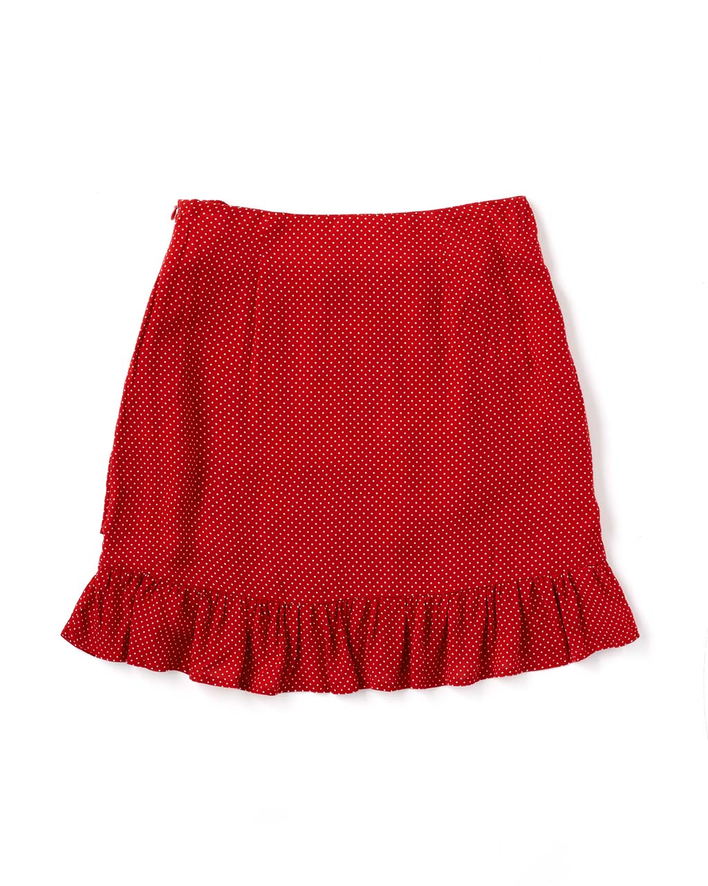 Back of red skirt with small white dots and ruffled hem laying flat on white background.
