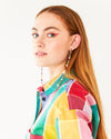 long beaded earrings with pearl, crystal, and African beads shown on model wearing a multi colored plaid shirt