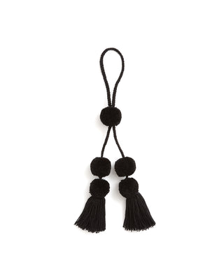 all black pom pom bag tassel