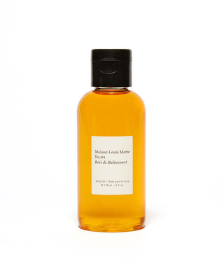 The No. 4 body oil by Maison Louis Marie comes in a clear bottle with black dispenser cap.