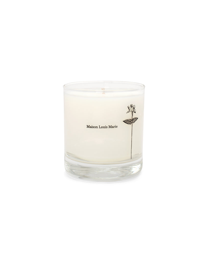 This casis candle by Maison Louis Marie is white and comes in a clear glass tumbler.