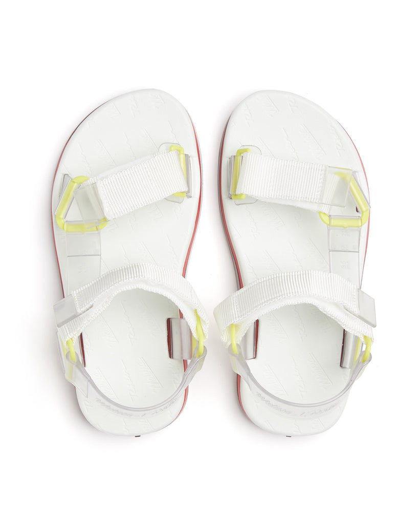 white strappy sandals with yellow details.