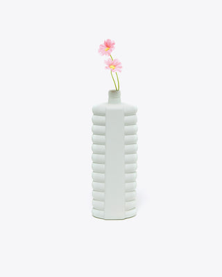 mint colored deco vase shown with flowers