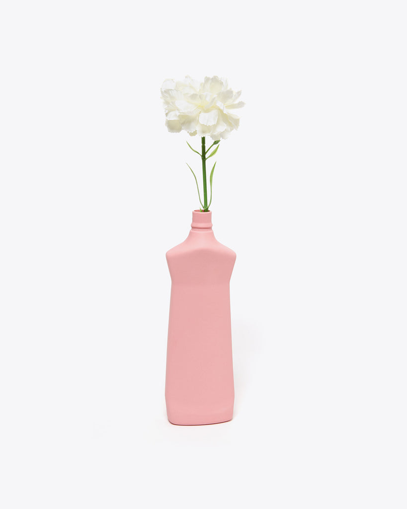 beet colored detergent bottle vase with flower