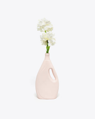 dusty pink vase shown with flowers