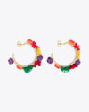 Gold hoop earrings with multi color floral accents