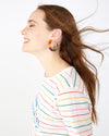 Gold hoop earrings with multi color floral accents shown on model