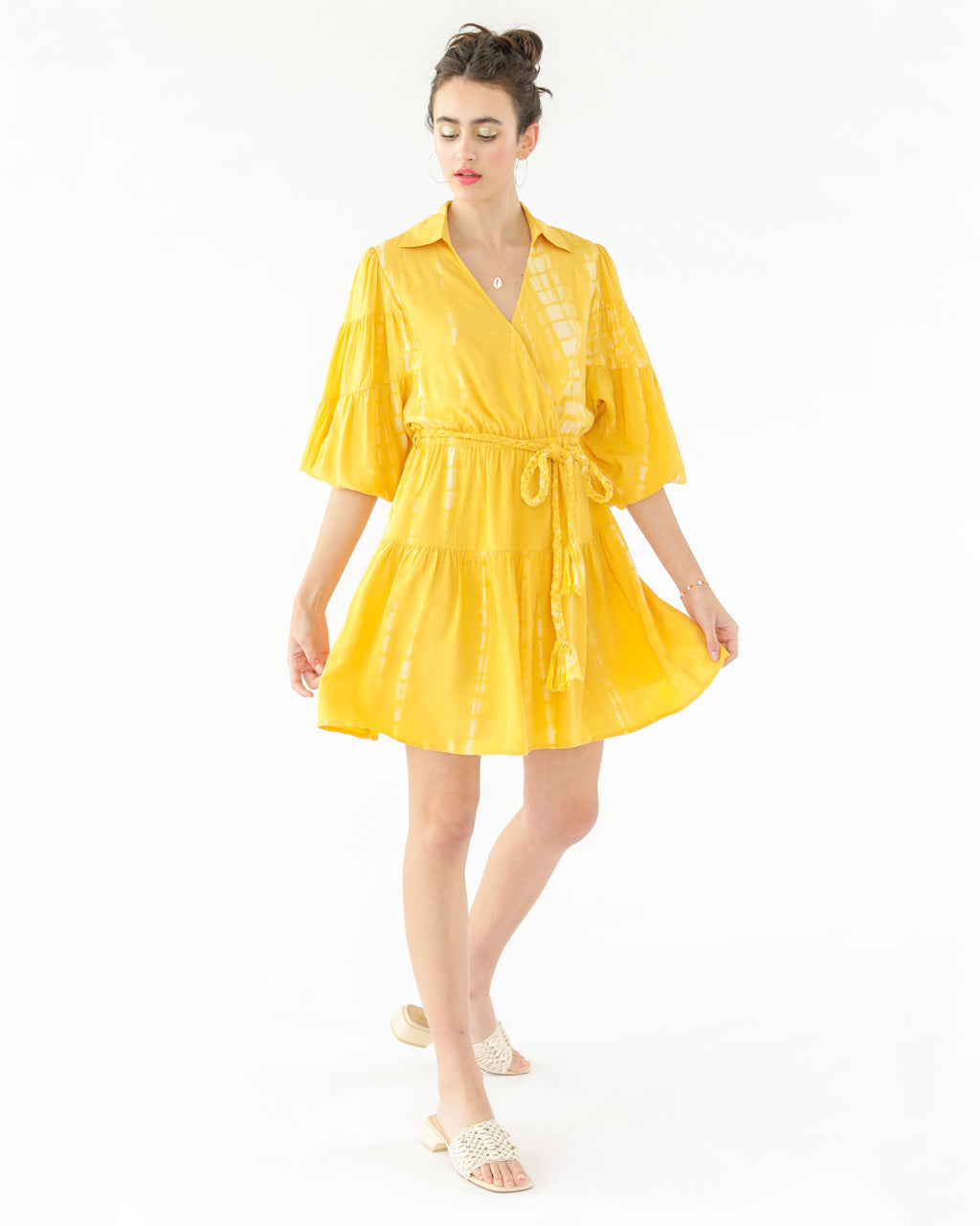 model wearing a yellow tie dye dress with a rope tie waist