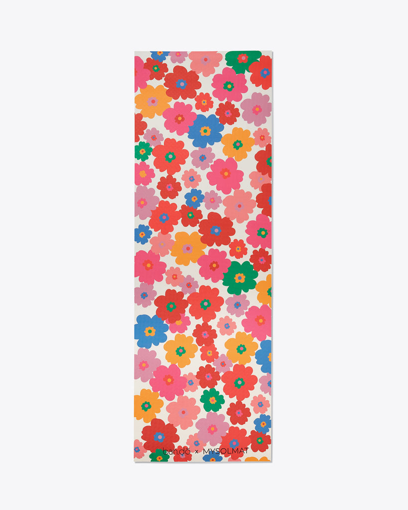exercise mat with multi-colored, all-over daisy pattern