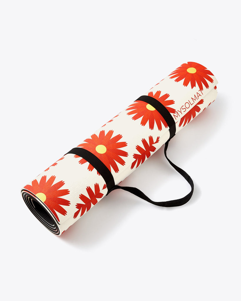 red floral exercise mat rolled up